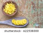 ginger root on wooden... | Shutterstock . vector #622538300