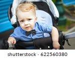 kid sitting in stroller. baby...   Shutterstock . vector #622560380
