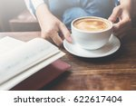 woman holding a cup of coffee...   Shutterstock . vector #622617404