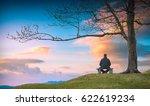 man sitting on a wooden bench... | Shutterstock . vector #622619234