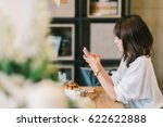 beautiful asian girl using... | Shutterstock . vector #622622888