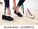 woman change shoes concept | Shutterstock . vector #622688513