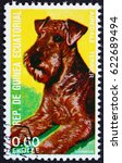 Small photo of CROATIA ZAGREB, 15 APRIL 2017: a stamp printed in Equatorial Guinea shows Airedale Terrier, Canis Lupus Familiaris, Pet, circa 1977