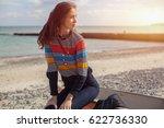 a girl sideways sitting near a... | Shutterstock . vector #622736330