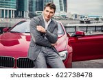 stylish man in a suit stands... | Shutterstock . vector #622738478