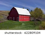 A Bright Red Barn In The...