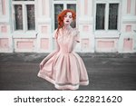 a woman with red curly hair in...   Shutterstock . vector #622821620