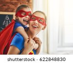 mother and her child playing... | Shutterstock . vector #622848830
