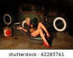 pin up girl in garage with a...