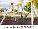 children swing at playground | Shutterstock . vector #622866410