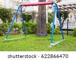 children swing at playground | Shutterstock . vector #622866470
