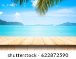 wooden table and beautiful sea... | Shutterstock . vector #622872590