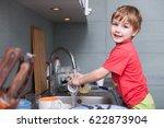 a little cute boy washing... | Shutterstock . vector #622873904