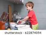 a little cute boy washing... | Shutterstock . vector #622874054
