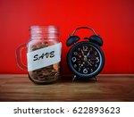 coins in glass jar for money... | Shutterstock . vector #622893623