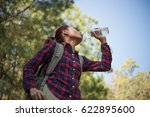 happy woman tourist with... | Shutterstock . vector #622895600