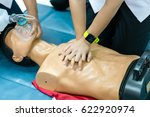 Small photo of Basic Life Support of Demonstrating chest compressions on CPR doll