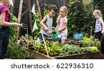 children are in the garden... | Shutterstock . vector #622936310