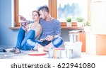 couple moving in house sitting... | Shutterstock . vector #622941080
