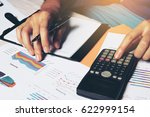 man doing finance with... | Shutterstock . vector #622999154