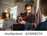 young couple working from home... | Shutterstock . vector #623008274