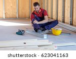 worker suffering after  on the... | Shutterstock . vector #623041163