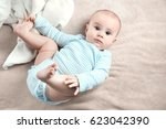 portrait of adorable baby on... | Shutterstock . vector #623042390