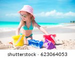cute little girl playing with... | Shutterstock . vector #623064053