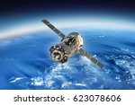 spaceship in space and earth on ... | Shutterstock . vector #623078606
