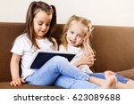 two adorable little sisters... | Shutterstock . vector #623089688