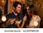 couple make toast as they... | Shutterstock . vector #623098028