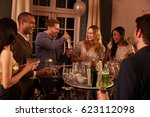 man making cocktails for... | Shutterstock . vector #623112098