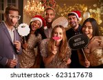 group of friends dressing up... | Shutterstock . vector #623117678