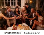 friends eating snacks as they... | Shutterstock . vector #623118170
