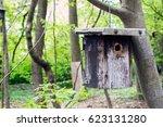 wooden birdhouse hanging on a... | Shutterstock . vector #623131280