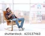 happy young man resting in... | Shutterstock . vector #623137463
