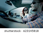 car interior and two lovers in... | Shutterstock . vector #623145818