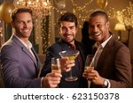 male friends celebrating at... | Shutterstock . vector #623150378