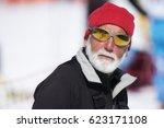 senior in winter sport clothes... | Shutterstock . vector #623171108