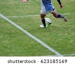 rugby player kicking off  | Shutterstock . vector #623185169