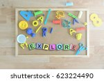 some colored cube letters on a... | Shutterstock . vector #623224490