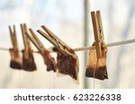 used tea bags hanging on the... | Shutterstock . vector #623226338