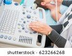 adult woman doctor scanning... | Shutterstock . vector #623266268