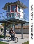 Small photo of CODROIPO, ITALY - AUGUST 19, 2016: Cyclist next to the Al Casale aerodrome control tower