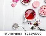 Stock photo herbal tea with roses on white wooden table top view 623290010