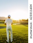 rear view of a young male... | Shutterstock . vector #623311604