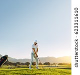 full length of male golfer... | Shutterstock . vector #623311610