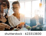business women discussing in... | Shutterstock . vector #623313830