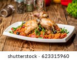 plate with roasted rabbit leg... | Shutterstock . vector #623315960