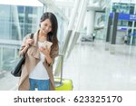 woman check flight number on... | Shutterstock . vector #623325170